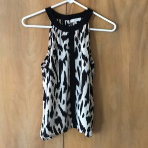 LUSH S soft animal print top with open back flows